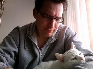 Sean Kelley with his cat, Zelke